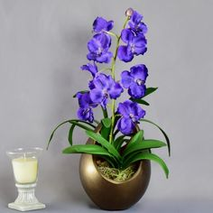 Purple Artificial Flowers, The Highest Quality Artificial Orchid Arrangement Made From Fresh Touch Vanda Orchid Stems And Set In A Gold Flame Planter. Artificial Silk Flowers, Fake Flowers, Vanda Orchids, Artificial Flower Arrangements, Glass Vase, Planters, Things To Come, Purple, Create