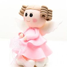 A girl angel figurine made out of migajon and a pink ribbon with the occasion, handmade party favors for baptism.