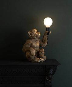 Koko Sitting Monkey Lamp Monkey Holding Bulb Lamp Our Koko Sitting Monkey Lamp Is A Cheeky Chap Who Looks Like He 39 S Holding Up A Peace Offering After A Spot Of Monkeying Around On The Furniture