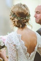 A Twisted Low Bun Wedding Hairstyle with Flower Crown