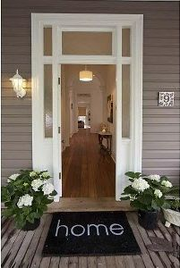 Love this entry way.  So pretty :)  DIY door mat? ( I wonder of we have room for sidelights and a transom over our door?)
