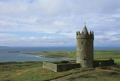 Looking over the Atlantic Ocean high above the village of Doolin in County Clare is 14th-century Doonagore Castle.
