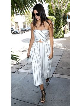 in a striped two-piece by Keepsake and Sophia Webster shoes in Los Angeles.   - HarpersBAZAAR.com