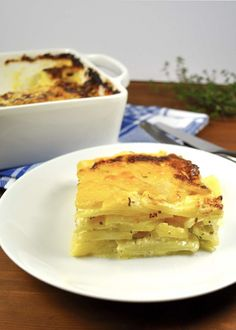 Potato Dauphinois (Gratin / Potato Bake) - potato, cream, cheese with a hint of garlic and thyme, The French are genius.