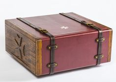 The exterior of the case was beautifully hand-carved by master woodcarver David Robinson (Callum's father), before beingtraditionally fumed to give the timber a rich, dark patina and wrapped in soft calf leather.It is secured with thick, oak-bark-tanned bridle leather straps, hand-fitted Conway loops and a pair of British made solid brass box locks.