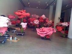Giant paper roses in a gallery, via Flickr.