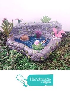 Miniature koi fish pond/grotto. With pink flowers and plants. Fairy garden accessories, dollhouse, terrarium décor. from Puppy Love Miniature http://www.amazon.com/dp/B01E1LDNNO/ref=hnd_sw_r_pi_dp_tktcxb0CC6K7B #handmadeatamazon