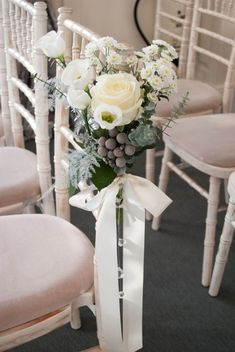 winter wedding flowers top table decoration chair flowers eaves hall wedding flowers by laurel weddings photography by phil d wedding hall