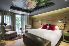 Boutique Hotel | Ceiling wallpaper | Roses | Wall cladding | Lampe Gras | Bulkhead | Oak | Interior design | Etienne Hanekom Interiors