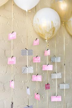 Whimsically modern brides will love the idea of using gold-painted balloons as a dynamic seating chart!  Put a table number on each balloon and then attach escort cards to the string. @myweddingdotcom