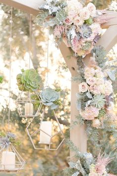 Navy and blush El Chorro wedding. Men in slate blue suits, ladies in blush-lavender chiffon full length gowns. White and blush florals with succulents galore. Wooden alter with blush chiffon curtains.  Hanging geometric candle holders.