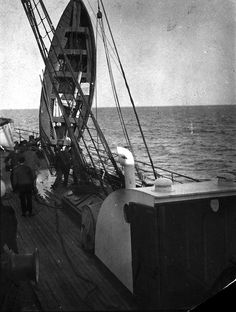 This uncaptioned photograph is presumed to be a TITANIC lifeboat being hoisted to drain it of water. - NARA - 278331.tif