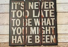 Three plank effect rustic wooden sign. `It's never too late to be.....` wording.