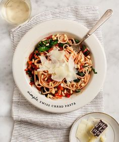 Easy-to-make vegan gluten-free brown rice pasta with chard tomatoes and white beans.