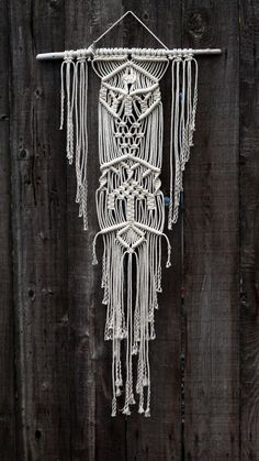 Macramé Wall Hanging on Drift Wood by FreeCreatures on Etsy https://www.etsy.com/listing/214834074/macrame-wall-hanging-on-drift-wood