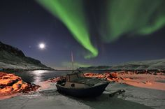 """With the Arctic darkness comes the """"Aqsaniq"""" Inuit term for the Northern Lights. Pangnirtung is a small community of about 1300 on Baffin Island in Nunavut, Canada. Photo by David Kilabuk"""