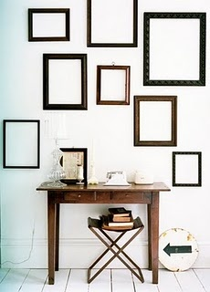 empty frames in a nice layout (I wonder if they were also having a hard time 'committing' to which photos to mat + frame?)