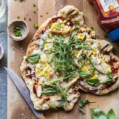 Summer heat means ZERO cooking indoors. Enter this grilled BBQ chicken pizza. It's sweet, spicy, cheesy, and made entirely on the grill. #HellmannsPartner The secret to this pizza is all in the homemade BBQ sauce. I make mine using my favorite #HellmannsKetchup (Made with 6 real, simple ingredients and sweetened ONLY with honey) and lots of spice. It's a summertime staple and I love using it as a base for pizza. Just top with pineapple, cheese, fresh corn, and garden herbs and dinner is…