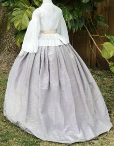 Ensemble: sheer muslin basque blouse with lilac moire skirt c.1858: back view
