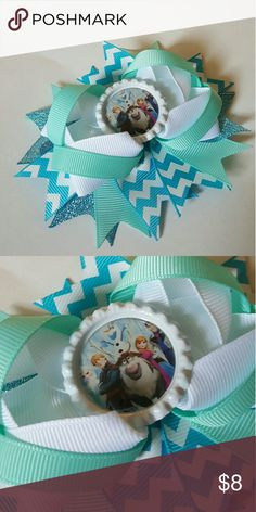 Frozen Chevron Hairbow Brand new. 4.5 inches.  Featuring all of the main characters in Frozen blue, aqua, and white chevron hairbow. Comes on an alligator clip.   Bundle and save!  Spend  $50 before shipping and get a FREE gift! Accessories Hair Accessories