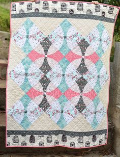 Follow this link to go to the blog post: http://www.kitchentablequilting.com/2015/10/wonderland-quilt-with-flowering.html wonderland flowering snowball quilt | by ericajackman