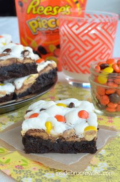 Reeses Rocky Road Brownies from insidebrucrewlife.com - brownies topped with marshmallows, peanuts, and two kinds of Reeses candies.