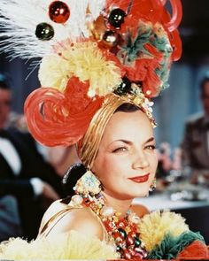 carmen miranda. this one would be pretty easy to do with tulle and christmas ornaments.