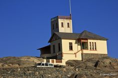 The Lighthouse, Shark Island, Luderitz, Namibia. Stayed in the lighthouse for 2 nights - awesome experience. Land Of The Brave, Lighthouses, Colonial, Road Trip, Africa, Construction, Island, Mansions, House Styles