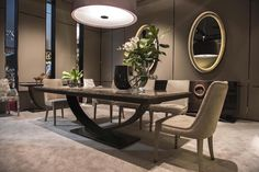 French designer Hugues Chevalier makes luxurious, one of a kind furniture since 1978. Designs are produced in his own workshops located in Vienna and Italy. His creations are contemporary yet timeless. On the photo you can see the dining table Haussmann with the gracefully curved stand underneath. | Visit us at  www.moderndiningtables.net #diningtables #homedecorideas #diningroomideas @ModDiningTables