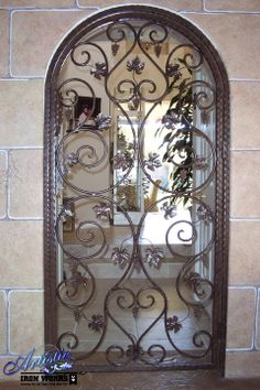 Arched Wrought Iron Wine Cellar Door