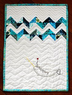 under the waves quilt - great idea! would work with applique also!