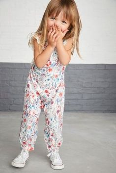 When you know you had the CUTEST outfit, you just have to shout about it! How adorable is this floral jumpsuit and trainer combo?
