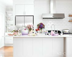 A kitchen island is a must-have in most people's dream kitchen. Kitchen Taps, Kitchen Dining, Kitchen Island, Kitchen Cabinets, Kitchen White, Dining Rooms, Garden News, White Subway Tiles, Splashback