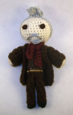 BBC Doctor Who's War Doctor with Sonic Screwdriver ( Handmade Crochet Doll ) by PaintsAndNeedles  ||  The front view picture kind of looks like he has a mohawk!  LOL  But I love his little beard and scarf!