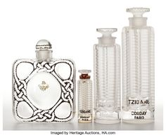 , FROM THE ESTATE OF SHIRLEY JACOBS ALTER. R. LALIQUE. Four Art Decoperfume bottles including three sizes of 'Tzigane' for ... (Total:4 Items)