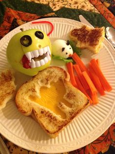 Scare up some Spooky Food for your kids' lunch! Ghostly egg-in-the-hole or grilled cheese sandwiches with a deviled egg mouse, carrot sticks and an apple monster. (The ooze in the corners of the monster's mouth is a crushed raspberry.) Boo!