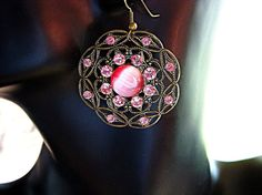 $33  Gorgeous pink cat's eye and Swarovski crystal earring. Round filigree antiqued brass components. Great boho earrings!