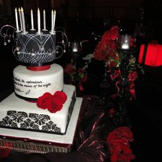 Phantom of the opera wedding cake. Black, white, red and silver are our color theme.