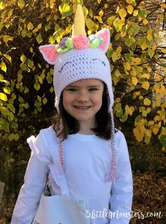 128abbd4fa7 A free pattern for an adorable crocheted unicorn hat with flowers and  leaves surrounding the horn