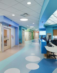 Circular recessed fluorescent overhead lights mimic the bubble design on the floor of this patient floor corridor at the Vidant Medical Center, James and Connie Maynard Children's Hospital, Greenville, N.C. Designed by HDR Architecture Inc. Photo: 2013 Don Schwalm/HDR Inc.