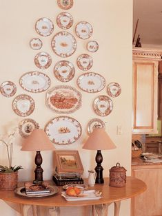 A collection of plates adorns the wall just off the kitchen in this French-country home.