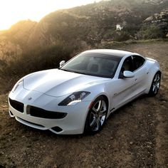 2012 Fisker Karma. 0-60 in 6.3 seconds. $102,000....... I'm thinking this screams GO TO SCHOOL FOR THE REST OF YOUR LIFE TO EVER BE ABLE TO AFFORD ME!:)