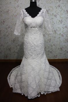 allure V neck mermaid middle length sleeves lace wedding gown with chapel train. $228.00, via Etsy.