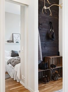 Black planked wall, apple crate storage, antlers in the entryway Decoration Inspiration, Interior Inspiration, Diy Shoe Rack, Shoe Racks, Crate Storage, Shoe Storage, Storage Room, Plank Walls, Home And Deco