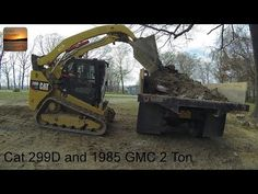 Cat 299D XHP Loading and a 1985 GMC 2-Ton Dumping - YouTube