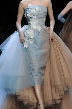 Fabulous Christian Dior.  Gorgeous Barbie doll like gown.  Strapless, fitted, column gown in multiple layers of sheer taupe and ice blue, creating a 'watercolor' type effect.  Accentuated by buttons running down the left side, from armpit to hip.  Full fan train in taupe and ice blue tulle attached to the back, like a bustle.  Final accents of silk flowers scattered down the front of the gown.