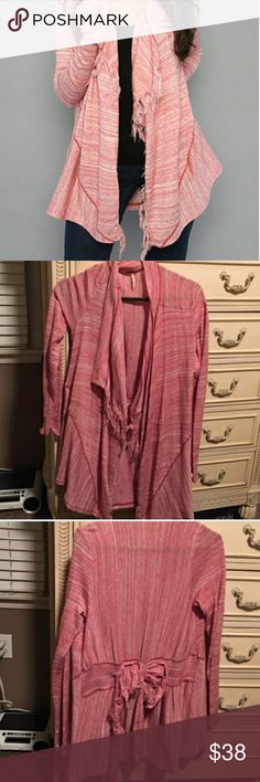 Free People Karmaloop Striped Fringe Cardigan Like New Condition is this gorgeous Free People Karmaloop Striped Fringe Cardigan in Pink, Size This mini stripe long cardi is super soft with fluttery hi-low hem and accent fringe as pictured. *82% Cotton, 18% Rayon. Retails $198.00 Free People Sweaters Cardigans