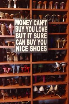 Can't buy love, CAN buy shoes <3... I totally want to buy this sign when I can actually have a walk-in closet, Instead of having to keep shoes under my bed :p