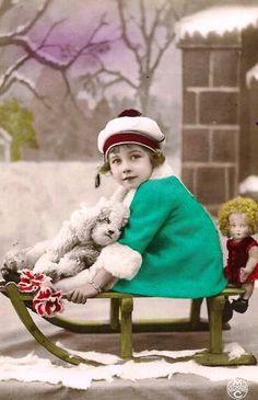 vintage Christmas postcard - child and dog on sled