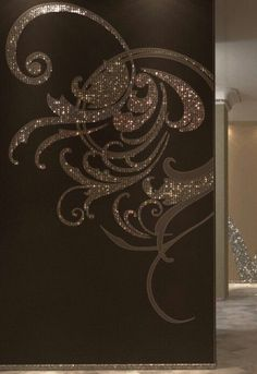Oh yes, one can be Gothic and still love glitter. This gives a pop of glam on a nice and dreary wall..